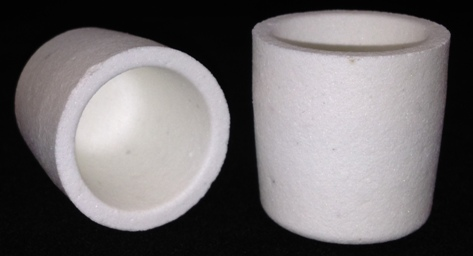 Alpha Resources Africa Product AR8030 in Ceramic Crucibles under Sample Containment.