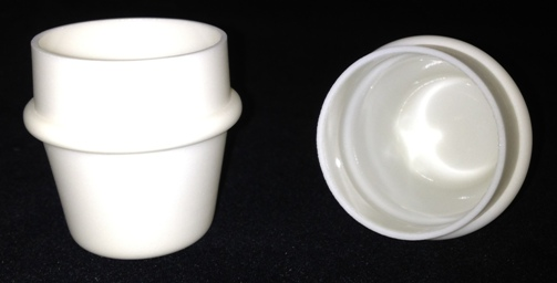 Alpha Resources Africa Product AR9042 in Ceramic Crucibles under Sample Containment.