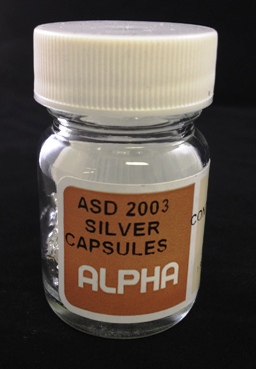 Alpha Resources Africa Product ASD2003 in Silver Capsules under Sample Containment.