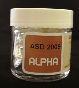 Alpha Resources Africa Product ASD2009 in Silver Capsules under Sample Containment.
