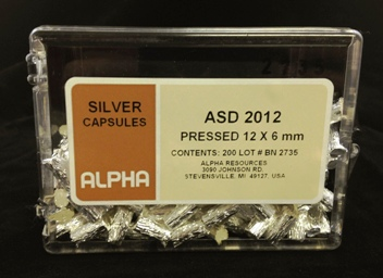 Alpha Resources Africa Product ASD2012 in Silver Capsules under Sample Containment.